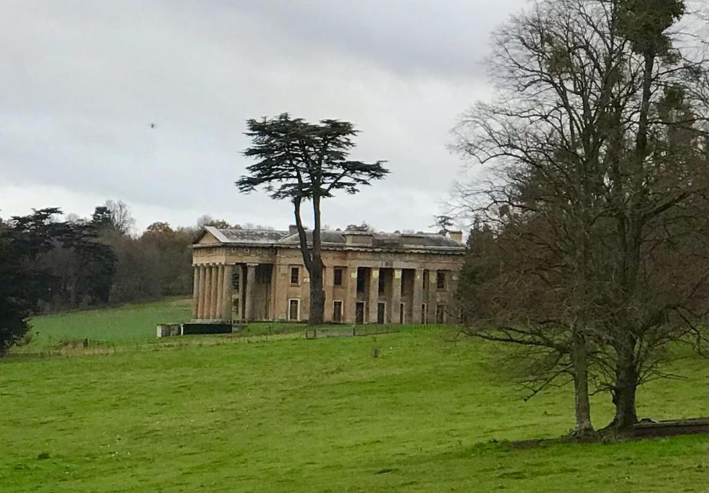 grand manor that looks like a greek temple